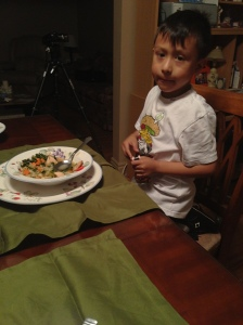 Anthony enjoys the healthy dinner his mother prepared